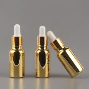 20Ml Anodized Rose Gold Cylindrical Essential Oil Glass Bottles With Pipette Dropper